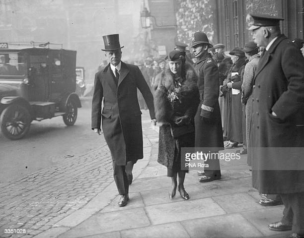 British politician Lord Waldorf Astor and Lady Nancy Astor arrive at the funeral of English writer Rudyard Kipling.