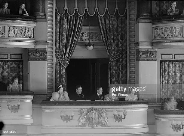 Members of the British Monarchy watching a performance of 'Pacific 1860' fromn the Royal Box of the Drury Lane Theatre London in aid of King George's...