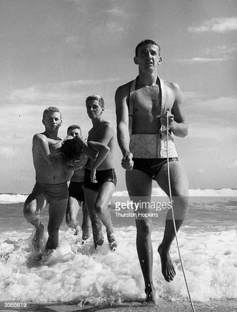 Part of a demonstration rescue by the LifeSaving Clubs of Sydney during the Surf Carnival Original Publication Picture Post 6832 Royal TourThe...
