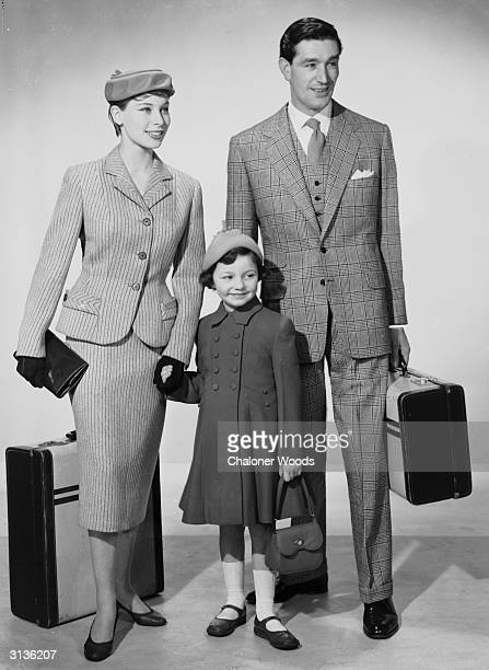 A family dressed and packed for a holiday