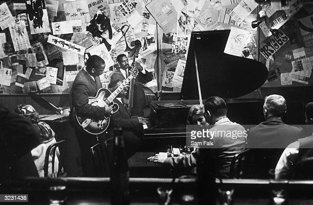 American jazz guitarist Wes Montgomery performs with his brothers Monk and Buddy in the Montgomery Brothers trio at the Five Spot nightclub on the...