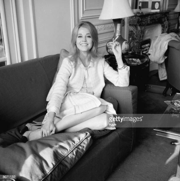 Actress Jane Fonda in the Savoy Hotel London puts her feet up and enjoys a relaxing cigarette
