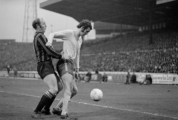 Manchester City's outside right, George Heslop , holds onto Chelsea's centre-forward Peter Osgood during a tackle in the FA Cup fourth round match at...