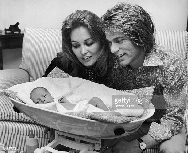 Pop singer and actor Adam Faith at his home in Henfield Sussex with his wife Jackie Irving and their fiveweek old daughter Katya who was born...