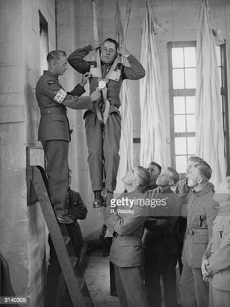 Royal Airforce officers demonstrating the advantages of a quick release harness at the School of Technical Training in Manston