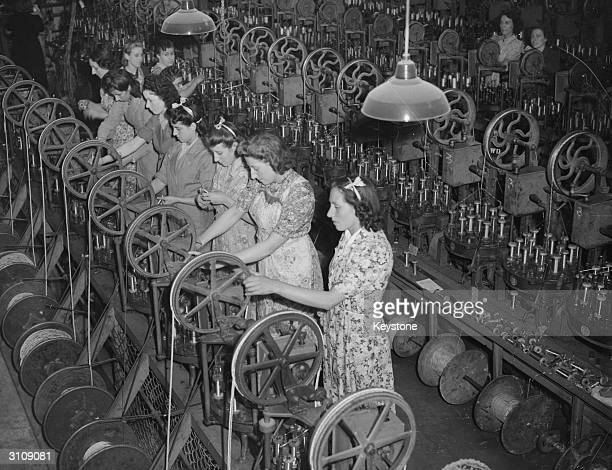 The seven Mills sisters work side by side at a munitions factory in Enfield during World War II From left to right they are Kitty Beryl Irene...