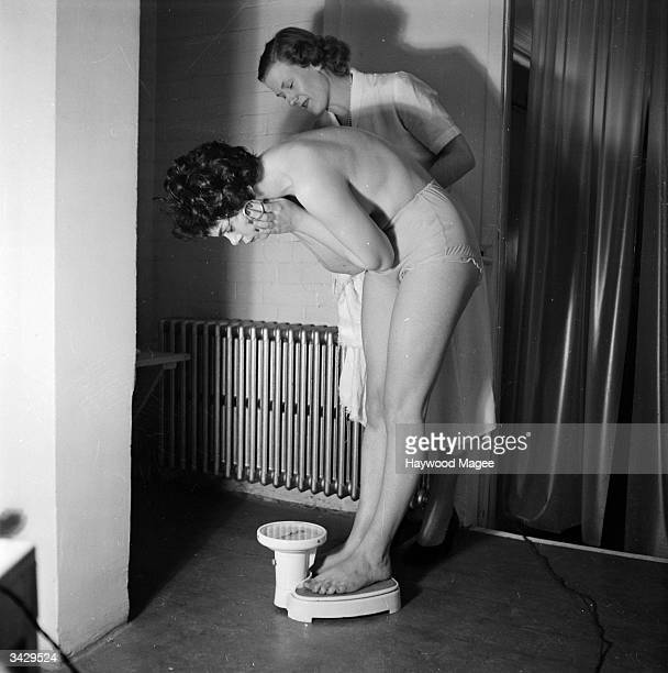 Actress Rachel Roberts checks her weight on the scales after a visit to a sauna in the classy London borough of Kensington Original Publication...