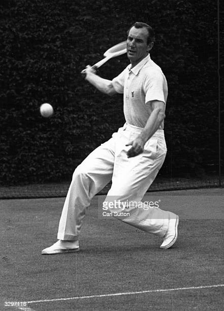 British tennis player Fred Perry , the first person ever to win all four major singles titles gives a demonstration of a forehand drive. Original...