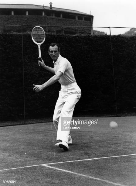 English tennis star Fred Perry the first person ever to win all four major singles titles gives an exhibition in correct play here demonstrating the...