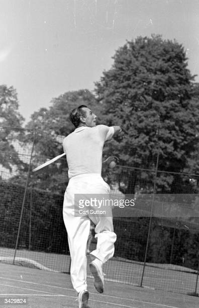 English tennis star Fred Perry , the first player ever to win all four major singles titles demonstrates a backhand volley on court. Original...