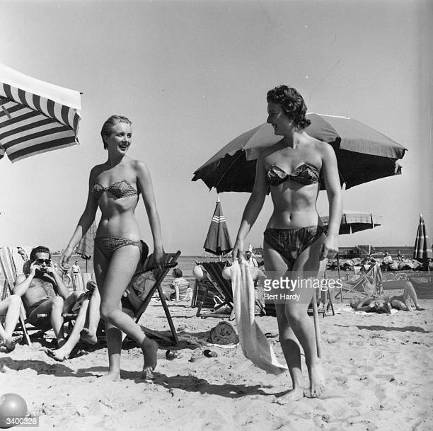 Models Jean and Jackie wearing the latest bikini fashion at a beach on the Riviera France Original Publication Picture Post 7850 Five Girls On A...