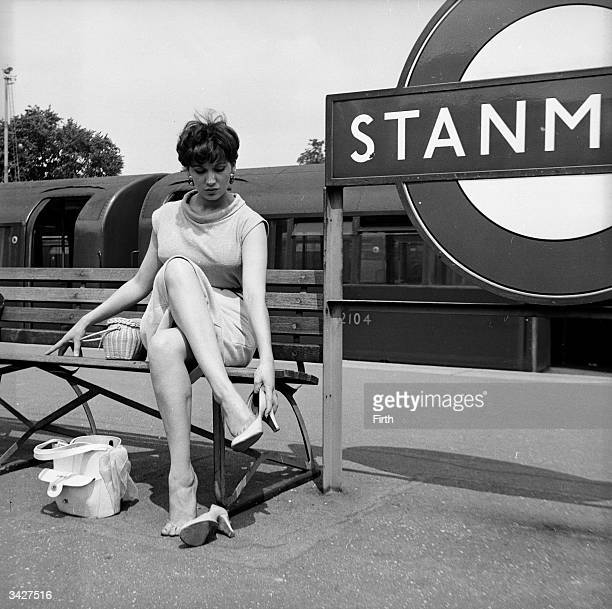 Aspiring actress Yvonne Warren slips off her high heels on the platform of Stanmore station in Middlesex