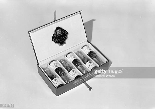 Presentation case containing six bottles of Charles Heidsieck champagne from a Reims vineyard.