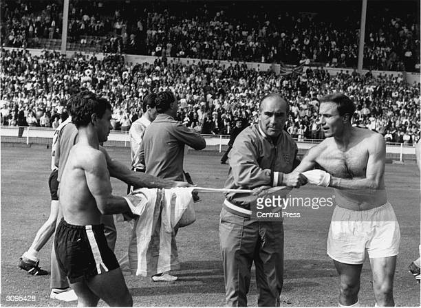 England football manager Alf Ramsey preventing George Cohen swapping his shirt with an Argentinian player after a bad tempered World Cup quarterfinal...