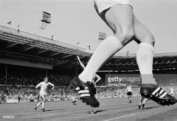 England football player Geoff Hurst jumps in jubilation after scoring England's winning goal against Argentina in the World Cup quarter final match...