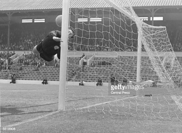 German goalkeeper Hans Tilkowski saves a shot on goal during West Germany's World Cup quarterfinal match against Uruguay at Sheffield's Hillsborough...