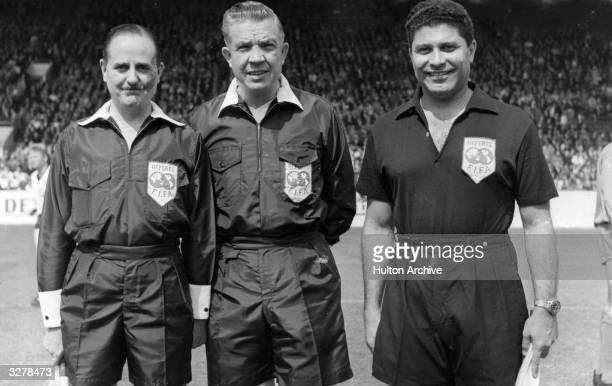 The referee and linesmen for the World Cup quarterfinal match between West Germany and Uruguay at Sheffield's Hillsborough stadium