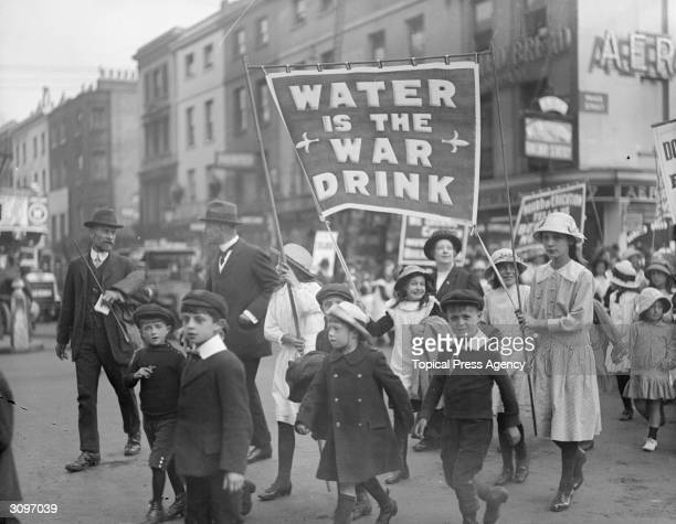 A children's rally in west London supporting prohibition The children are carrying a banner which reads 'Water is the War Drink'