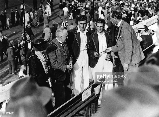 England cricket captain Douglas Jardine presents certificates to England and Nottinghamshire Cricketers Harold Larwood and Bill Voce at Trent Bridge,...