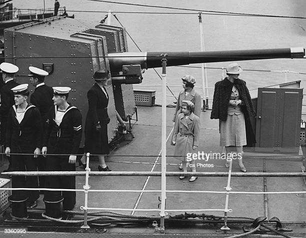 Princesses Elizabeth and Margaret Rose on board the Royal Navy destroyer Kempenfelt at Portsmouth waiting to sail to the Solent to meet their parents...