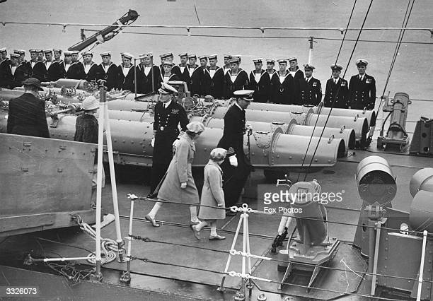 The Royal Princesses Elizabeth and Margaret going aboard the destroyer Kempenfelt to meet their parents in the Solent
