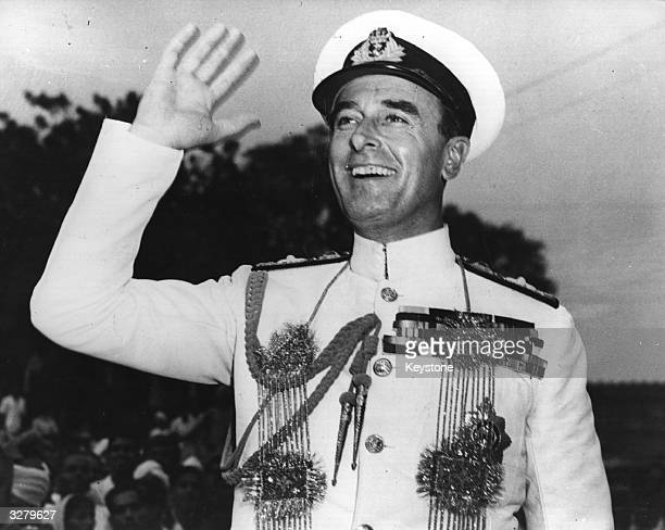 Lord Louis Mountbatten the last Governor General from Britain waving a cheery farewell to the crowds in Delhi