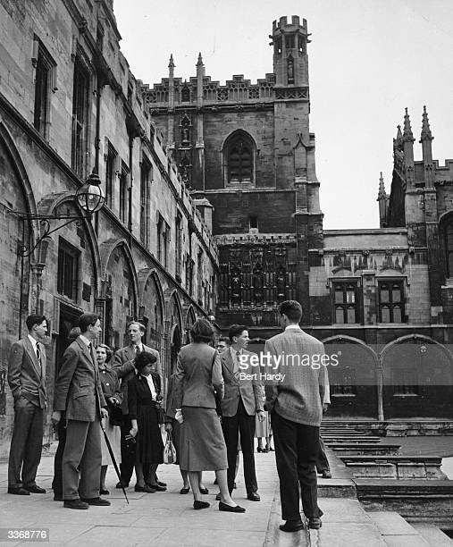 A group of students at Oxford University showing tourists how the university really lives for $8 which includes lunch coffee and a trip to Eton...