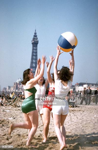 A group of young women play with a beach ball on Blackpool beach