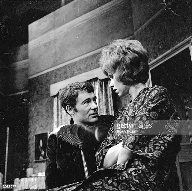 Wendy Craig perches on Peter O'Toole's knee during a rehearsal of the play 'Ride a Cock Horse' by William Barrow
