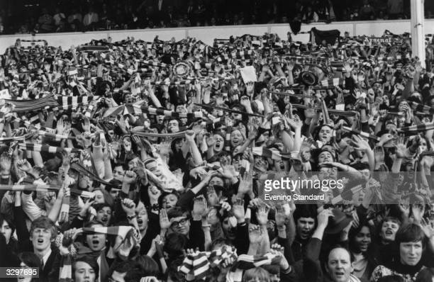 Arsenal fans cheering on their team during the 1971 FA Cup final against Liverpool which they won 21