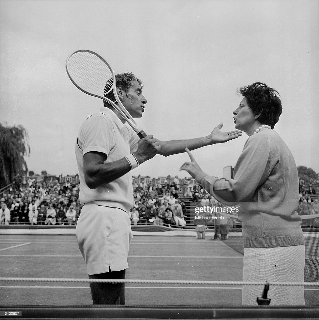 Pancho Gonzales of the US disagrees with a line judge's decision and argues his case with the referee Bea Seal during the Rothmans London Grass Court Championships at Queen's Club.
