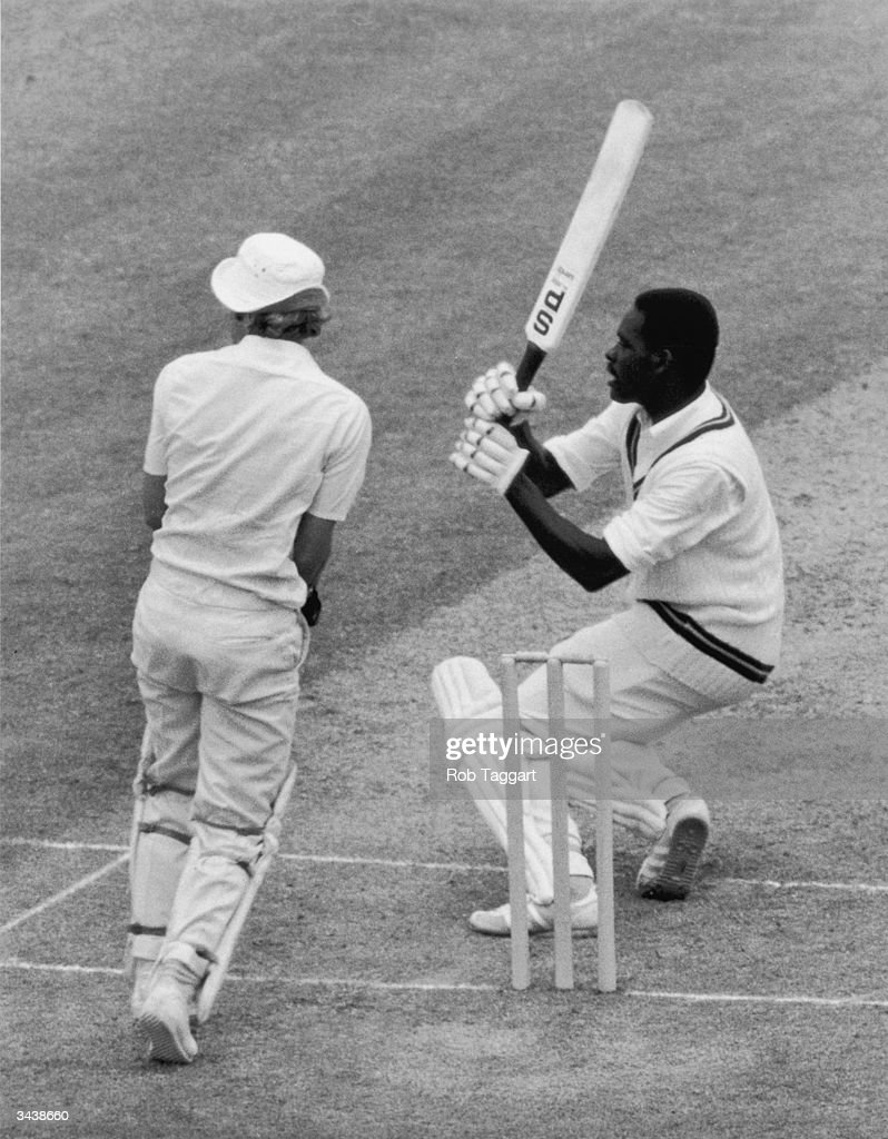 West Indian batsman Collis King hits a ball from W Larkins during the World Prudential Cup Final against England at Lord's. Wicket keeper R Taylor looks on.