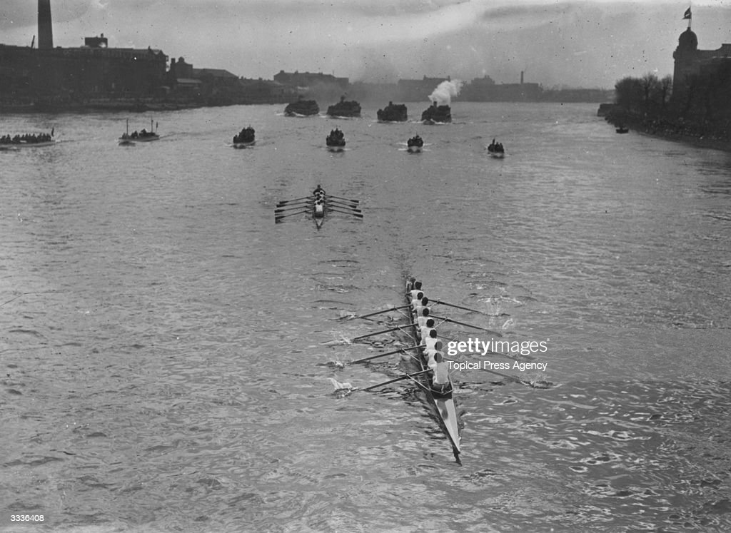 Centenary of the Oxford and Cambridge, Cambridge are leading by a length at Hammersmith Bridge and went on to win.