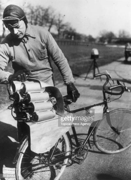 German engineer Richter and his rocket bicycle with 12 rockets mounted on the back wheel enabling him to reach a speed of 90kph before it exploded...