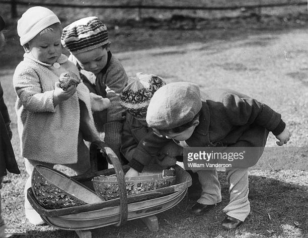 Orphans from Castlebar Nursery School in Sydenham who have been evacuated to MershamleHatch near Ashford in Kent celebrate Easter whilst awaiting...