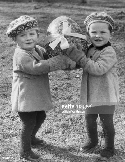 Twins from Castlebar Nursery School in Sydenham who have been evacuated to MershamleHatch near Ashford in Kent celebrate Easter whilst awaiting...