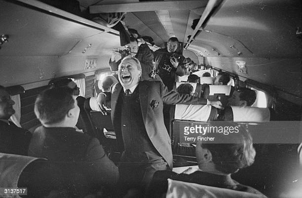 Conservative Party leader Edward Heath joins in the fun on board an aircraft during his 1966 electioneering campaign