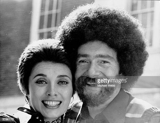 Hairdresser Vidal Sassoon with his wife Beverly wearing a false beard sideburns and wig to mark the opening of his new barbers shop