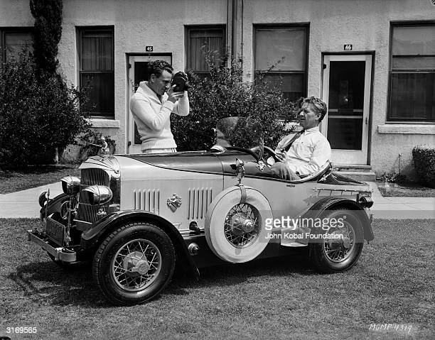American director of silent films Fred Niblo born Federico Nobile being filmed in his car