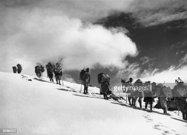 A group of climbers in the clouds at the Tragbal Pass in the Himalayas on their way to climb Nanga Parbat the fourth highest mountain in the world