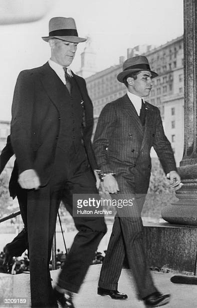 Sicilianborn New York mafia boss Charles 'Lucky' Luciano walks handcuffed into the Supreme Court for the continuation of his vice trial