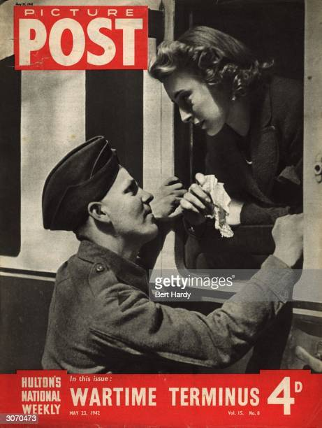 British soldier bids a fond farewell to his girl as she boards a train at a London station during World War II. The headline beneath reads 'Wartime...