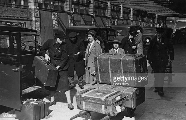 Women porters working at Paddington Street Railway Station in wartime London Original Publication Picture Post 1133 Wartime Terminus pub1942