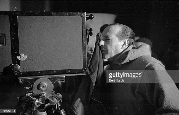 Italian film director Roberto Rossellini viewing the rushes for his film 'Visit to Italy' Original Publication Picture Post 6514 Ingrid Bergman's...