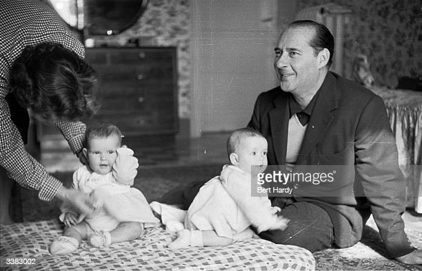 Swedish actress Ingrid Bergman with her husband film director Roberto Rossellini and their elevenmonthold twins Original Publication Picture Post...