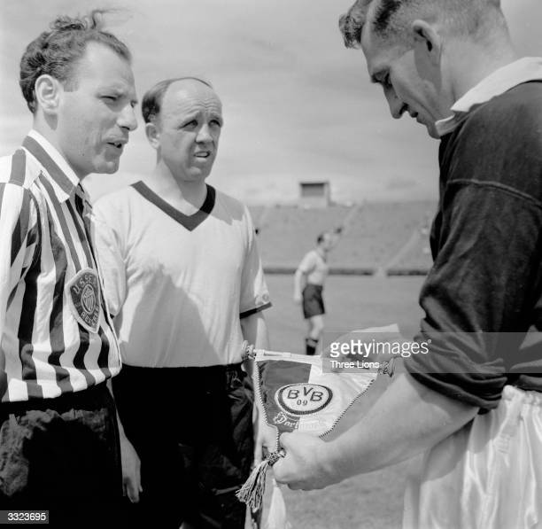 The teams captains of Chelsea and Borussia Dortmand football clubs exchange club memorabilia shortly before the kick off of a match in New York.