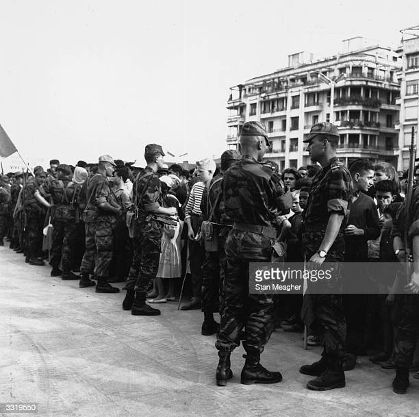 French troops holding back crowds in front of Government House Algiers during the Algerian War of Independence