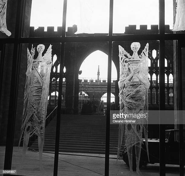 The old cathedral at Coventry, visible through the engraved glass screen, by John Hutton, inside the new cathedral.