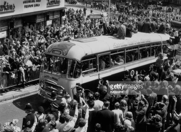 Crowd watching as members of the West Ham United team celebrate after their victory in the European Cup Winners Cup. Bobby Moore, the team captain,...