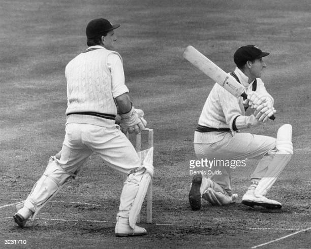 The Australian cricket captain and left handed batsman William Morris Lawry better known as Bill Lawry sweeping the ball away to cover during a...